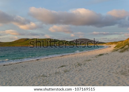 Sunrise at Vatersay beach Vatersay (Scottish Gaelic: Bhatarsaigh) is an inhabited island in the Outer Hebrides of Scotland. Vatersay is also the name of the only village on the island. - stock photo