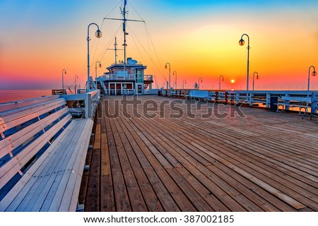Sunrise at wooden pier in Sopot, Poland. - stock photo