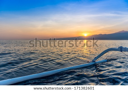 Sunrise bali on a traditional fishing boat in Bali, Indonesia - stock photo