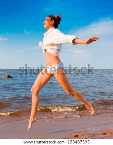 Sunrise Beach Exercise - stock photo