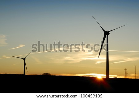 Sunrise behind a windfarm in Cornwall, UK. - stock photo