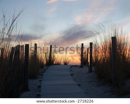 Sunrise Beyond a Dune - stock photo