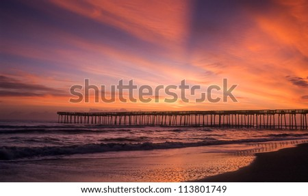Sunrise brings about a brand new day in the outer banks of North Carolina. - stock photo