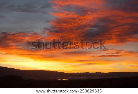 Sunrise Comes over Owens Lake Sierra Nevada Range California - stock photo