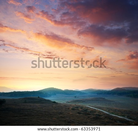 Sunrise composition. Hills of mountain. - stock photo