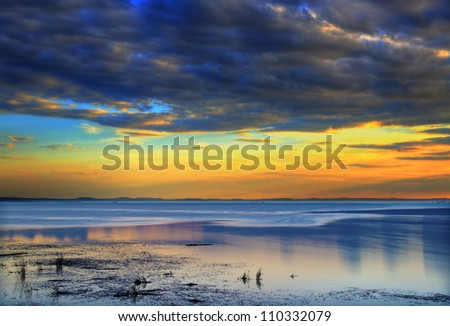 sunrise Dawn of the clouds over the lake - stock photo