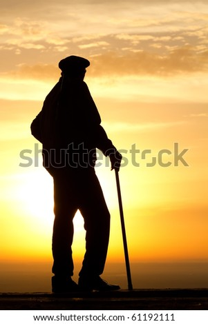 Sunrise  dawn   old  man   silhouette - stock photo