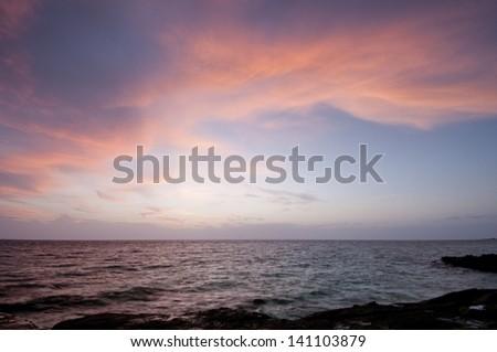 Sunrise from the beach at  Isla Pacheca shore. Las Perlas Archipelago, Panama Province, Panama, Central America. - stock photo