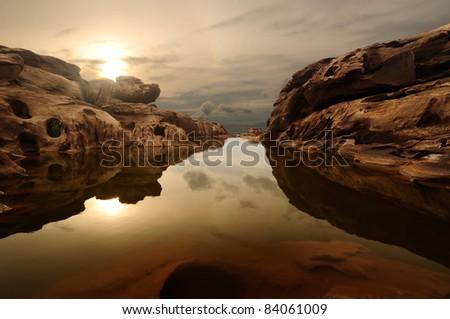 sunrise head dog at Sam Phan Bhok Grand Canyon, Mekhong river, Ubon Ratchathani, Thailand - stock photo