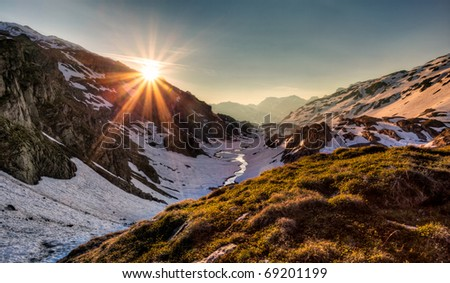 Sunrise in a swiss alps valley