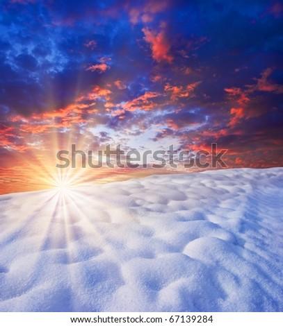 sunrise in a winter snowbound plain - stock photo