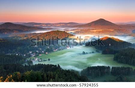 Sunrise in beautiful mountain Czech switzerland with inversion - stock photo