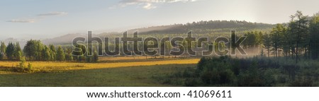 Sunrise in forest on Russian Far East. Panoramic View - stock photo