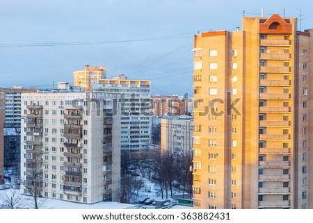 sunrise in living quarter in city in cold winter morning - stock photo