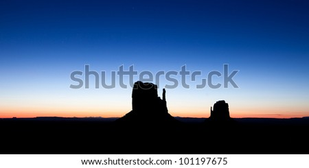 Sunrise In Monument Valley Arizona, With The Buttes In Silhouette - stock photo