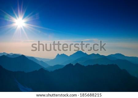 Sunrise in mountain - stock photo