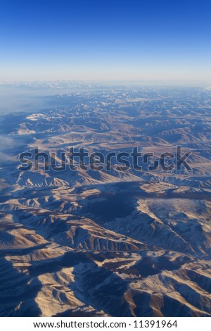Sunrise in mountains from stratosphere - stock photo