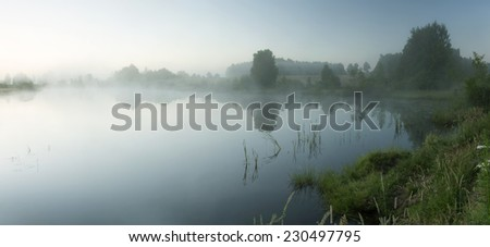 Sunrise in north Poland. Misty and calm conditions.Panoramic photography/The World at Rest  - stock photo