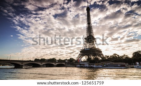Sunrise in Paris along Seine River, with the Eiffel Tower - stock photo