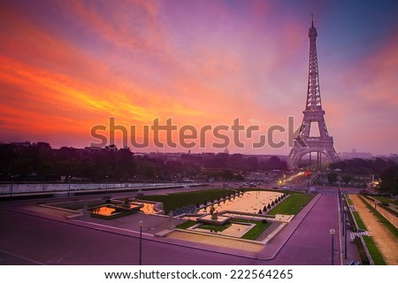 Sunrise in Paris, with the Eiffel Tower from Trocadero. The Trocadero square and Eiffel tower is the most visited tourist attractions in France. - stock photo