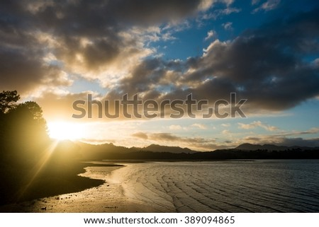 sunrise in sea bay New Zealand  - stock photo