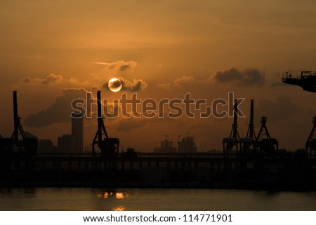 Sunrise in Singapore container terminal. - stock photo