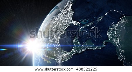 Sunrise in space. View on the night Earth with city lights glowing on the dark side. North America, Caribbean and South America region. Elements of this image furnished by NASA. 3d illustration