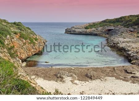 Sunrise in the Cala Brafi beach in Majorca at dawn - stock photo