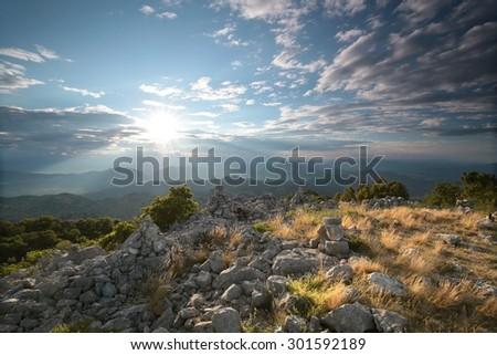 Sunrise in the Dinaric mountains, Croatia. - stock photo