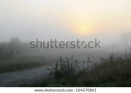 sunrise in the field - stock photo