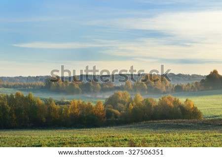 Sunrise in the fog in the fields - stock photo