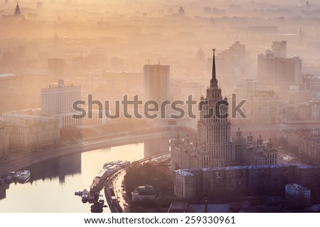 Sunrise in the foggy day over Moscow. Hotel Ukraine, Moskva river, building of Russian Government - stock photo