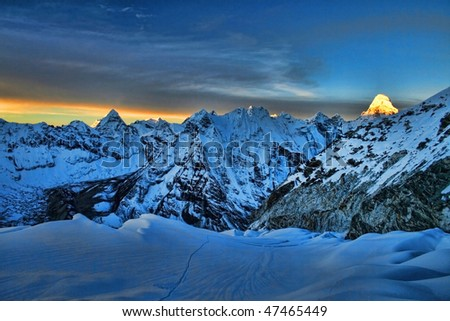 Sunrise in the Himalayas, as seen from 6000 m high, Everest Region - stock photo
