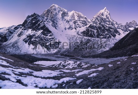 Sunrise in the Himalays. Taboche and Cholatse Mountain peaks - stock photo