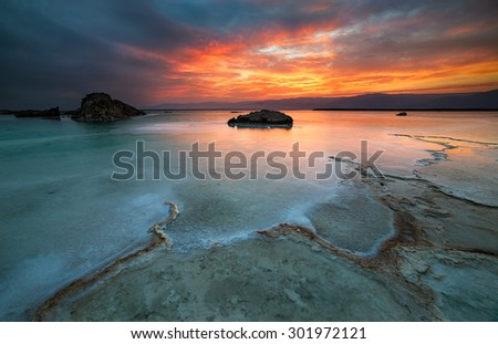 Sunrise in the lower place on Earth. The Dead sea is a lake located in the border between Israel and Jordan. Its shores are 427 meters below sea level making it the Earth's lowest elevation on land. - stock photo