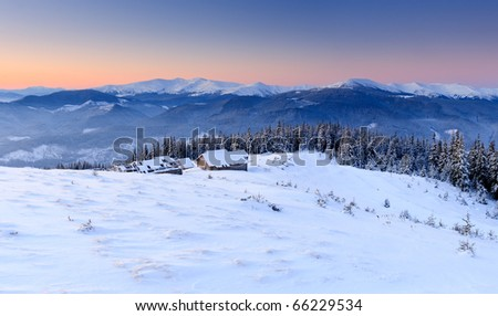 Sunrise in the mountains in winter on a cold morning. Mountain house