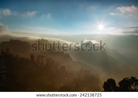 Sunrise in the mountains Sri Lanka  - stock photo