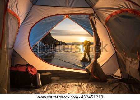 Sunrise inside a Tent. Camping concept - stock photo