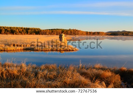 Sunrise landscape of lake in Bashang grassland,Hebei province, China
