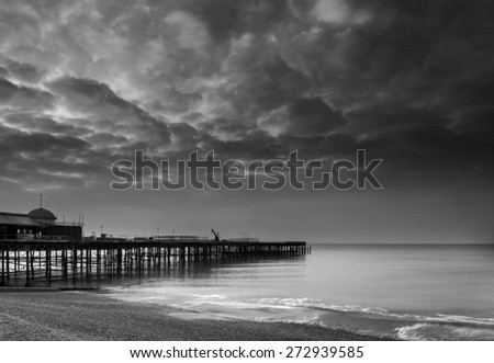 Sunrise landscape over pier under construction and development in black and white - stock photo