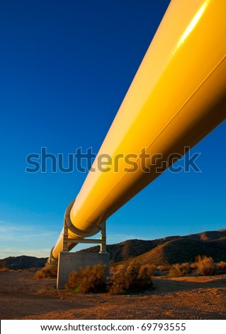 Sunrise light on a pipeline in the Mojave Desert, California. - stock photo