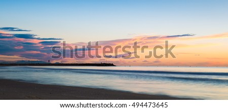 Sunrise long exposure  photo off the beach  at Valencia in Spain at the Mediterranean Sea