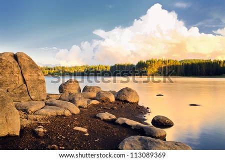 sunrise meet on the beauty mountain lake - stock photo