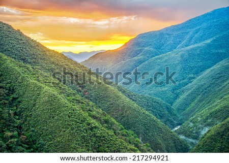 Sunrise of lush green jungle covered hills in Cotopata National Park near Coroico, Bolivia - stock photo