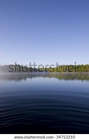 Sunrise on a lake - stock photo