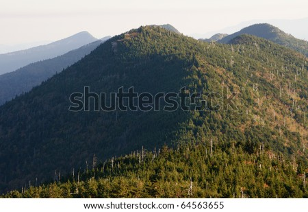 sunrise on a mountainside from the summit of Mount Mitchell - stock photo