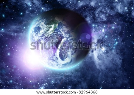 sunrise on blue planet Earth in deep space - stock photo