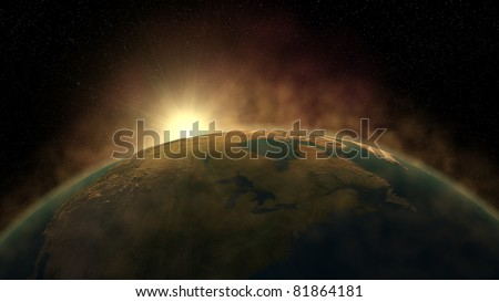Sunrise on earth as seen from space - stock photo