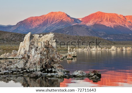 Sunrise on lake Mono in a crater of an ancient extinct volcano. Lake shallow, in it set of picturesque reeves of the Tufa - stock photo