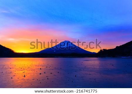 Sunrise on Mount Fuji and the frozen Lake Shojiko - stock photo